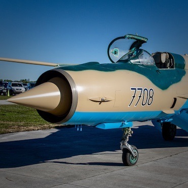 Mig-21 Static Exhibit from the Florida Air Museum with tan, aqua, and blue-green paint scheme and canopy open
