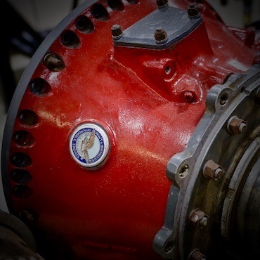 A red Pratt & Whitney aircraft engine close up from the Florida Air Museum static displays