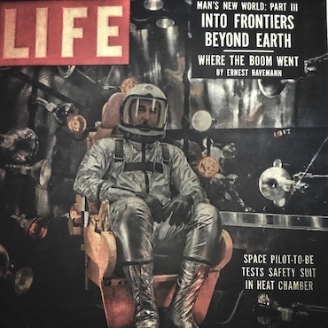 "Life Magazine vintage cover with headline ""Man's New World: Into Frontiers Beyond Earth"" and a photo of an astronaut"