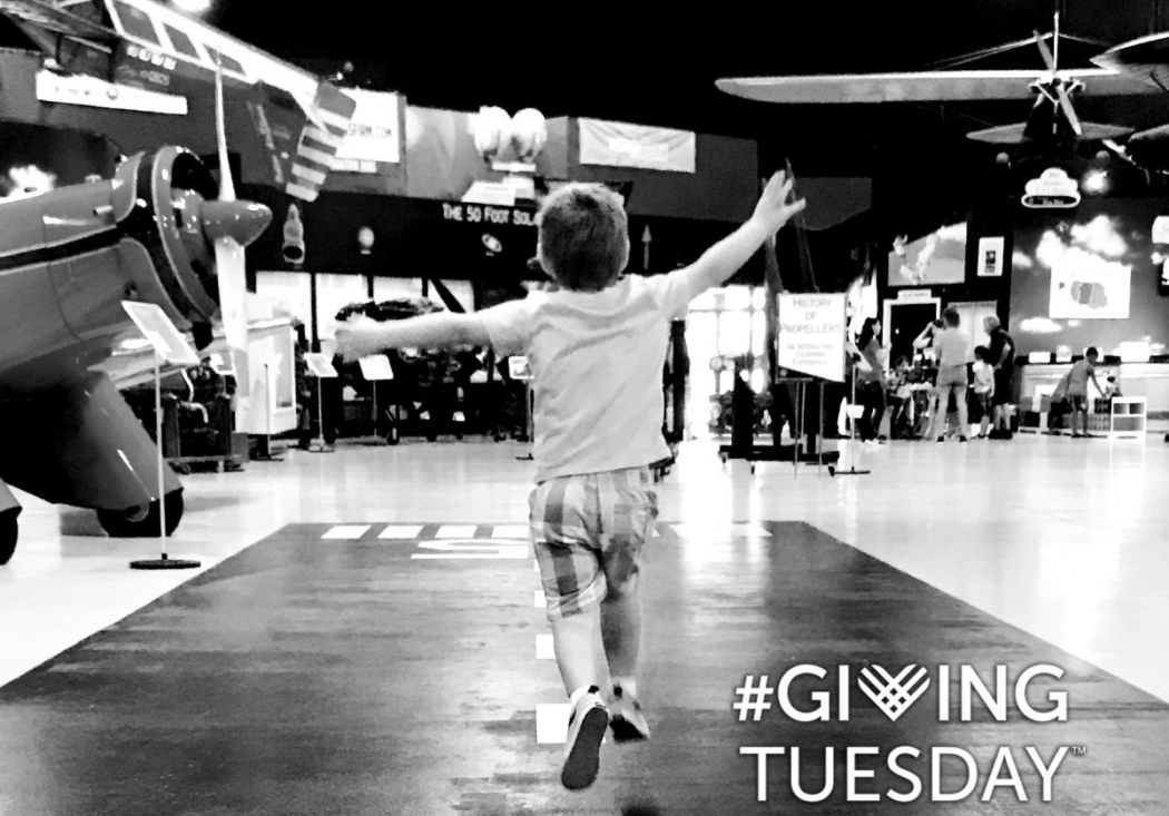 Young boy running down the central runway at the Aerospace Discovery at Florida Air Museum in celebration of #givingtuesday.