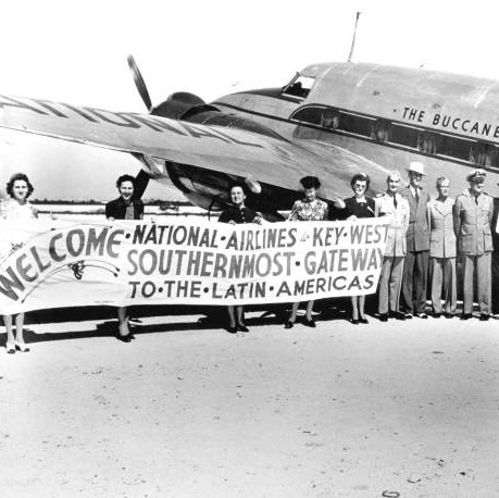 National Airlines plane with people in front Buccaneer Route